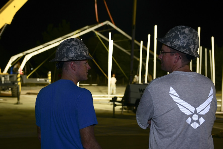 U.S. Air Force Col. Todd Stratton, 39th Mission Support Group commander, left, speaks with Maj. Myles Gilbert, 39th Civil Engineer Squadron commander, Aug. 7, 2016, at Incirlik Air Base, Turkey. The two spoke about an 8K dome shelter being built. (U.S. Air Force photo by Tech. Sgt. Caleb Pierce)