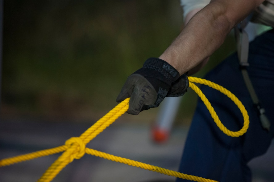 U.S. Air Force Senior Airman Bradley Dilworth, 49th Material Maintenance Squadron electrical power production specialist, from Holloman Air Force Base, N.M., pulls a rope Aug. 8, 2016, at Incirlik Air Base, Turkey. The rope was being used as an aid to construct an 8K dome shelter. (U.S. Air Force photo by Airman 1st Class Devin M. Rumbaugh)