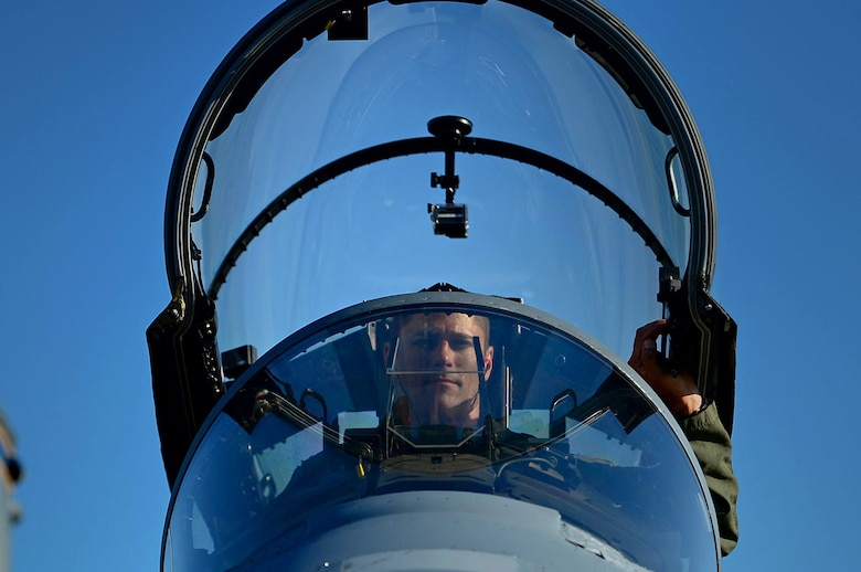 U.S. Air Force Maj. Benjamin Leestma, California Air National Guard 194th Expeditionary Fighter Squadron F-15C Eagle pilot, prepares to depart a 493rd Fighter Squadron F-15D Eagle after completing a training flight at Ämari Air Base, Estonia, Aug. 24, 2016. The 493rd FS, assigned to Royal Air Force Lakenheath, England, and, the 194th EFS assigned to the California ANG in Fresno, are participating in a flying training deployment with 16 F-15C Eagle aircraft alongside national allies in focus of maintaining security and building partnership capacity with Estonia. (U.S. Air Force photo by Senior Airman Erin Trower/Released)