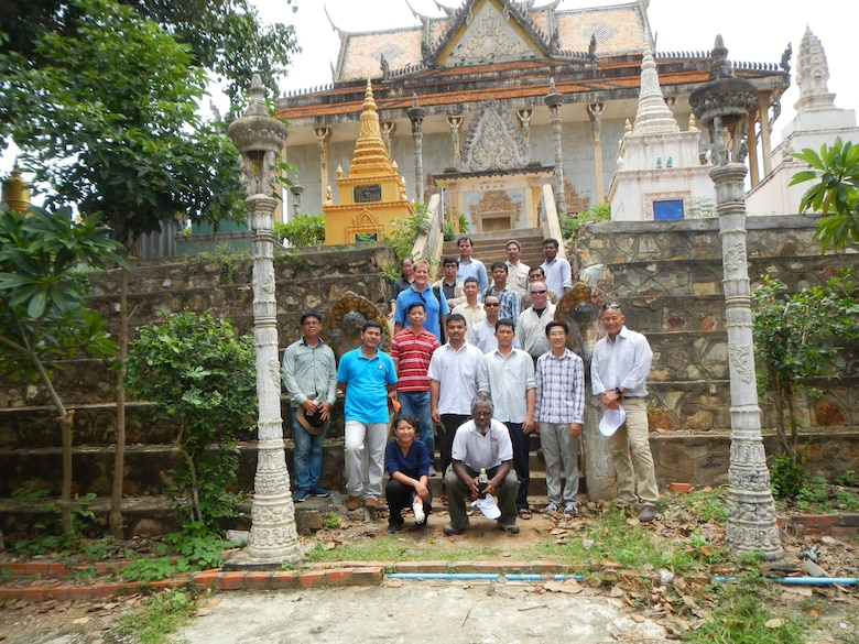 Participants and instructors posed for a photo in front of a Buddhist temple in the Kampong Cham Province during a groundwater modeling workshop in Cambodia Aug 9-11. The workshop was designed to provide an overview of groundwater principles and modeling tools that can help engineers, planners, and water resources managers make more informed decisions