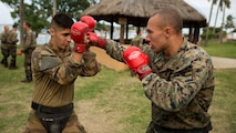 French Army Pfc. Quentin Antomarchi, left, an infantryman, and Cpl. Joseph J. Bennetti, a machine gunner, box during a French Armed Forces Nautical Commando Course at Quartier Gribeauval, New Caledonia, August 16, 2016. The course is a part of Exercise AmeriCal 16, a bilateral training exercise designed to enhance mutual combat capabilities and improve relations with our partners by exchanging a U.S. Marine Corps and French Armed Forces infantry platoon. While the U.S. Marines are in New Caledonia, the French infantry platoon traveled to Australia to participate in Exercise Koolendong 16 with U.S. and Australian forces. Antomarchi from Toulouse, France, is with 92nd Infantry Regiment, French Army. Bennetti, from New York, New York, is with Marine Rotational Force – Darwin.