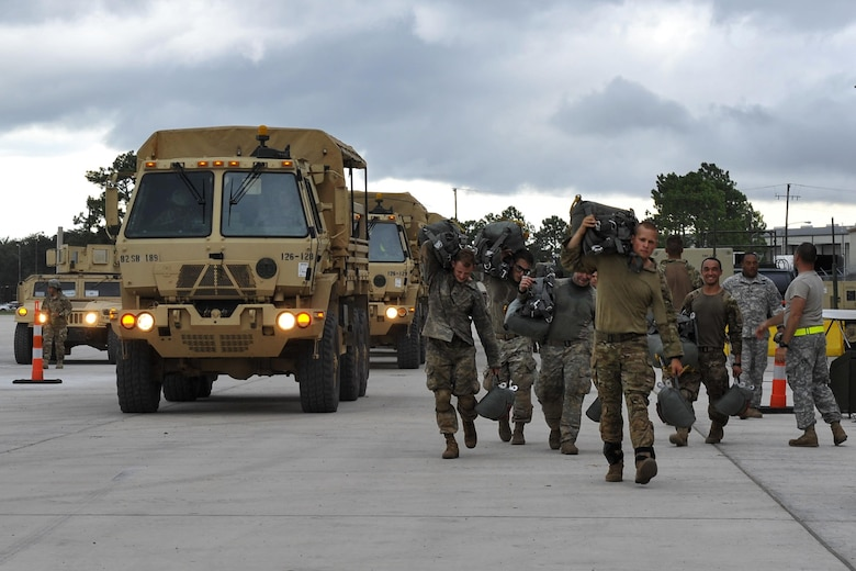 U.S. Army soldiers assigned to the 3rd Brigade Combat Team, 82nd Airborne Division from Fort Bragg, N.C., arrive at an intermediate staging base Aug. 18, 2016, near Fort Polk, La. Approximately 750 paratroopers jumped from Air Mobility Command aircraft in support of Exercise Green Flag Little Rock 16-09. (U.S. Air Force photo by Airman Kevin Sommer Giron)