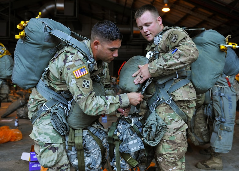 U.S Army soldiers secure their parachutes prior to a static-line jump in support of Exercise Green Flag Little Rock 16-09 Aug. 18, 2016, near Fort Polk, La. During the exercise, approximately 740 paratroopers were airdropped to include U.S. Air Force and U.S. Army personnel. (U.S. Air Force photo by Airman Kevin Sommer Giron)