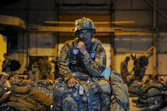 U.S. Army Spc. Brady Spillane, 82nd Airborne Division forward observer, prepares for a static-line jump in support of Exercise Green Flag Little Rock 16-09 Aug. 18, 2016, near Fort Polk, La. Spilllane is one of approximately 740 paratroopers to jump from Air Mobility Command aircraft during Green Flag. (U.S. Air Force photo by Airman Kevin Sommer Giron)