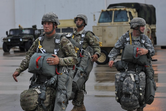 U.S. Army soldiers assigned to the 3rd Brigade Combat Team, 82nd Airborne Division from Fort Bragg, N.C., prepare to board a C130J for a static-line jump in support of Exercise Green Flag Little Rock 16-09 Aug. 18, 2016, near Fort Polk, La. 19th Airlift Wing aircraft dropped 24 sorties into the landing zone after a mass personnel drop of approximately 740 paratroopers. (U.S. Air Force photo/Amn Kevin Sommer Giron)