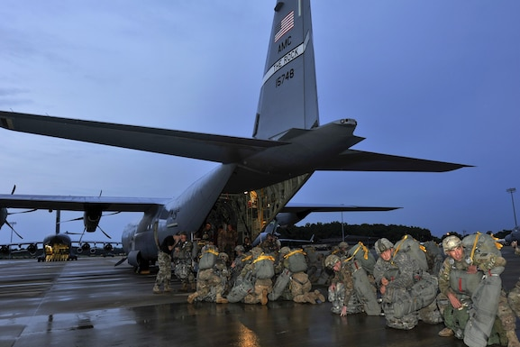 U.S. Army soldiers assigned to the 3rd Brigade Combat Team, 82nd Airborne Division from Fort Bragg, N.C., board a C-130J for a static-line jump in support of Exercise Green Flag Little Rock 16-09 Aug. 18, 2016, near Fort Polk, La. Six C-130Js assigned to Little Rock Air Force Base, Ark., and Dyess Air Force Base, Texas, participated in the exercise, lending their airlift capabilities to the 3rd BCT paratroopers. (U.S. Air Force photo by Airman Kevin Sommer Giron)