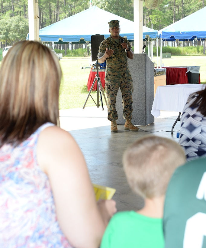 Major Lee Taylor, retired, keynote speaker, explains how reading and winning go hand-in-hand during Marine Corps Logistics Base Albany's Summer Reading Awards Program at Covella Pond, Aug. 20.