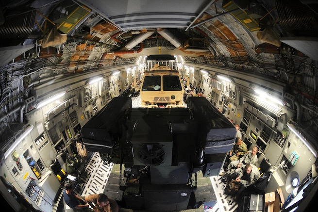 U.S. and Canadian soldiers wait for takeoff after uploading an Avenger air defense system, which uses surface-to-air missiles to provide protection for ground units, onto a Canadian air force Globemaster III aircraft in Greenville, S.C., Aug. 13, 2016. Army National Guard photo by Staff Sgt. Roby Di Giovine