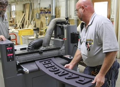 Muscatatuck, Ind.- Bill LaFollette and Shawn Kostek work together to produce special order projects at the Muscatatuck Urban Training Center Carpentry Shop in Butlerville, Ind., Aug. 22, 2016. Both have worked here for the past 20 years. (U.S. Army Photo by Spc. Eddie Serra)