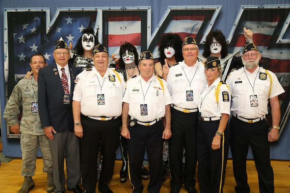 "Col. Adam Willis, 445th Airlift Wing commander, along with the Color Guard from the Veterans of Foreign Wars Post 3438, West Carrollton, Ohio, pose with the rock band, KISS, during the band's performance Aug.22, 2016. KISS is currently on a 40-city ""Freedom To Rock"" tour to honor U.S. veterans across the nation and provides donations to the U.S. Chamber of Commerce Foundation's Hiring Our Heroes program. (Courtesy photo)"