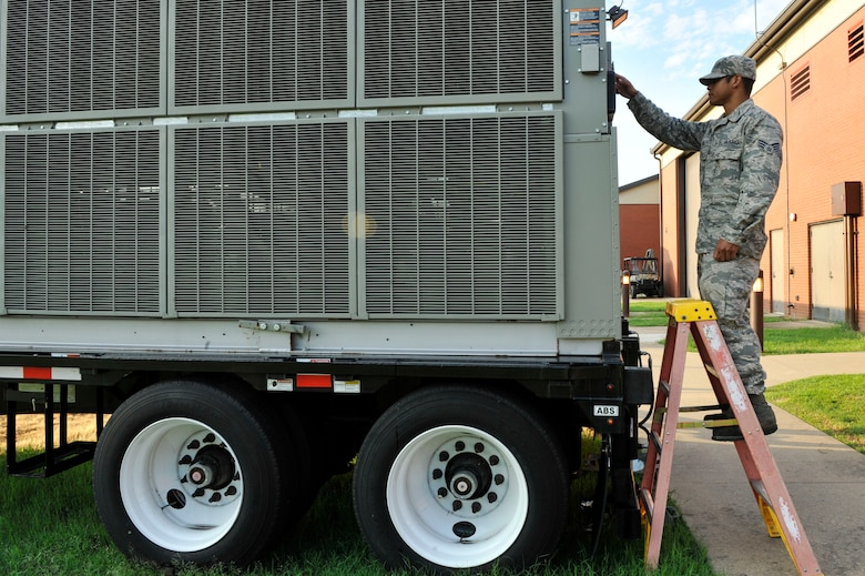 U.S. Air Force Senior Airman Pierre Hill, 19th Civil Engineer Squadron heating, ventilating and air conditioning journeyman, performs an operational check on a portable chiller Aug. 9, 2016, at Little Rock Air Force Base, Ark. Portable chillers are used when a building's main air and conditioning unit malfunctions. (U.S. Air Force photo by Senior Airman Stephanie Serrano)