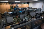 U.S. Airmen from the 51st Mission Support Group work inside of the Deployment Readiness Control Center (DRCC) during Exercise Beverly Herd 16-2 at Osan Air Base, Republic of Korea, Aug. 26, 2016. Team Osan's DRCC serves as the hub for Airmen, cargo and equipment that deploy to and from Osan during exercises and real world contingencies. (U.S. Air Force photo by Senior Airman Dillian Bamman)