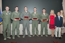 The 2011, 2012, 2014 and 2015 Lt. Col. Anthony C. Shine Fighter Pilot Award winners received engraved knives from Shine's family during a ceremony at Joint Base Langley-Eustis, Va., Aug. 11, 2016. Maj. Gen. Thomas Deale, left, the Air Combat Command Headquarters director of operations, presented the winners their awards with the Shine family. (U.S. Air Force photo/Staff Sgt. R. Alex Durbin)