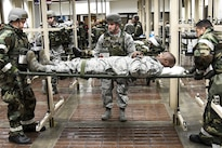 Airmen transport a mock patient to a stretcher in an aeromedical evacuation training scenario during Exercise Beverly Herd 16 on Osan Air Base, South Korea, Aug. 24, 2016. The training allows medics to hone their skills on safety transporting patients to aircraft. Air Force photo by Staff Sgt. Jonathan Steffen