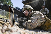Air Force Staff Sgt. Robert Converse fires the M240 machine gun during a training event at the Suffolk County Range in Westhampton Beach, N.Y., Aug. 24, 2016. Converse is assigned to the New York National Guard's 106th Rescue Wing. Air National Guard photo by Staff Sgt. Christopher S. Muncy