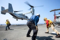 Sailors guide a landing MV-22 Osprey onto the flight deck of the amphibious assault ship USS Bonhomme Richard in the Philippine Sea, Aug. 24, 2016. The Richard is operating in the U.S. 7th Fleet area of operations to support security and stability in the Indo-Asia-Pacific region. Navy photo by Petty Officer 2nd Class Diana Quinlan