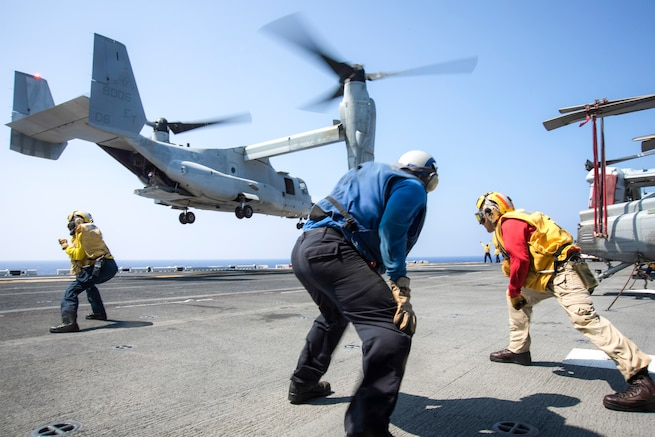 Sailors guide an MV-22 Osprey onto the amphibious assault ship USS Bonhomme Richard in the Philippine Sea, Aug. 24, 2016. The Richard is operating in the U.S. 7th Fleet area of operations to support security and stability in the Indo-Asia-Pacific region. Navy photo by Petty Officer 2nd Class Diana Quinlan