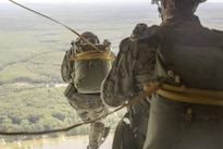 Marines jump from the back of a C-130 during Exercise Northern Strike 2016 at Camp Grayling Joint Maneuver Training Center, Mich., Aug. 17, 2016. The exercise unites about 5,000 service members from 20 states and three coalition countries to provide accessible, readiness-building opportunities for military units from all service branches. Marine Corps photo by Lance Cpl. Devan Barnett