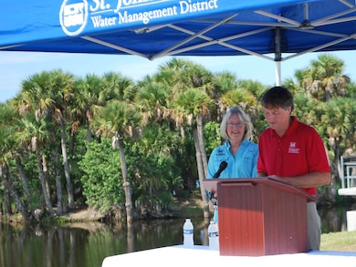 """Tim Murphy and Dr. Ann Shortelle highlight successes of the St. Johns River Upper Basin Project during a ceremony Aug. 23 at the Fellsmere Grade Recreation Area where a large group gathered to celebrate the project's completion. Murphy, Jacksonville District deputy for Programs and Project Management, and Shortelle, executive director of the St. Johns River Water Management District, and other key speakers consistently mentioned the partnership and perseverance over four decades that built nature back into the basin system to provide flood protection, marsh restoration, isolate agricultural runoff and freshwater releases into the Indian River Lagoon, and restore wildlife habitat over 166,000 acres in Brevard and Indian River counties. In July 2016 the upper basin project was recognized as the """"Project of the Century"""" by the Florida Society of Engineers, competing against such inventive projects as air conditioning and the Hubble Space Telescope. According to the engineering committee, the projects illustrated """"long‐term engineering solutions providing for the betterment of the citizens of the state, their health, public safety, and welfare. These projects provide witness of engineering excellence in their local community."""""""