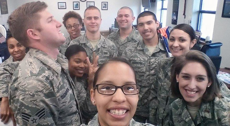 U.S. Air Force Senior Airman Shannon Hall, center, takes a photo with her co-workers to celebrate her original Air Force anniversary March 3, 2015, at Dyess Air Force Base, Texas. Hall joined the Air Force March 3, 2009 and was medically retired in 2011. When she found out she was misdiagnosed and fought to get back in, she re-enlisted January 28, 2013. (Courtesy photo)