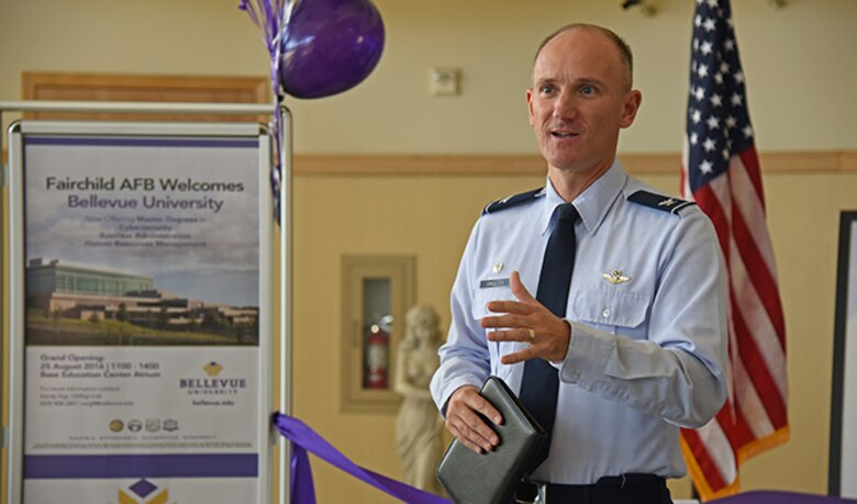 Col. Ryan Samuelson, 92nd Air Refueling Wing commander, discusses the important role education plays in the Air Force during the ribbon-cutting ceremony for Bellevue University Aug. 25, 2016, at Fairchild Air Force Base. Bellevue University is one of four schools the base education center offers. Bellevue is a private, regionally accredited, non-profit school nationally recognized as a military-friendly institution. (U.S. Air Force photo/Airman 1st Class Mackenzie Richardson)