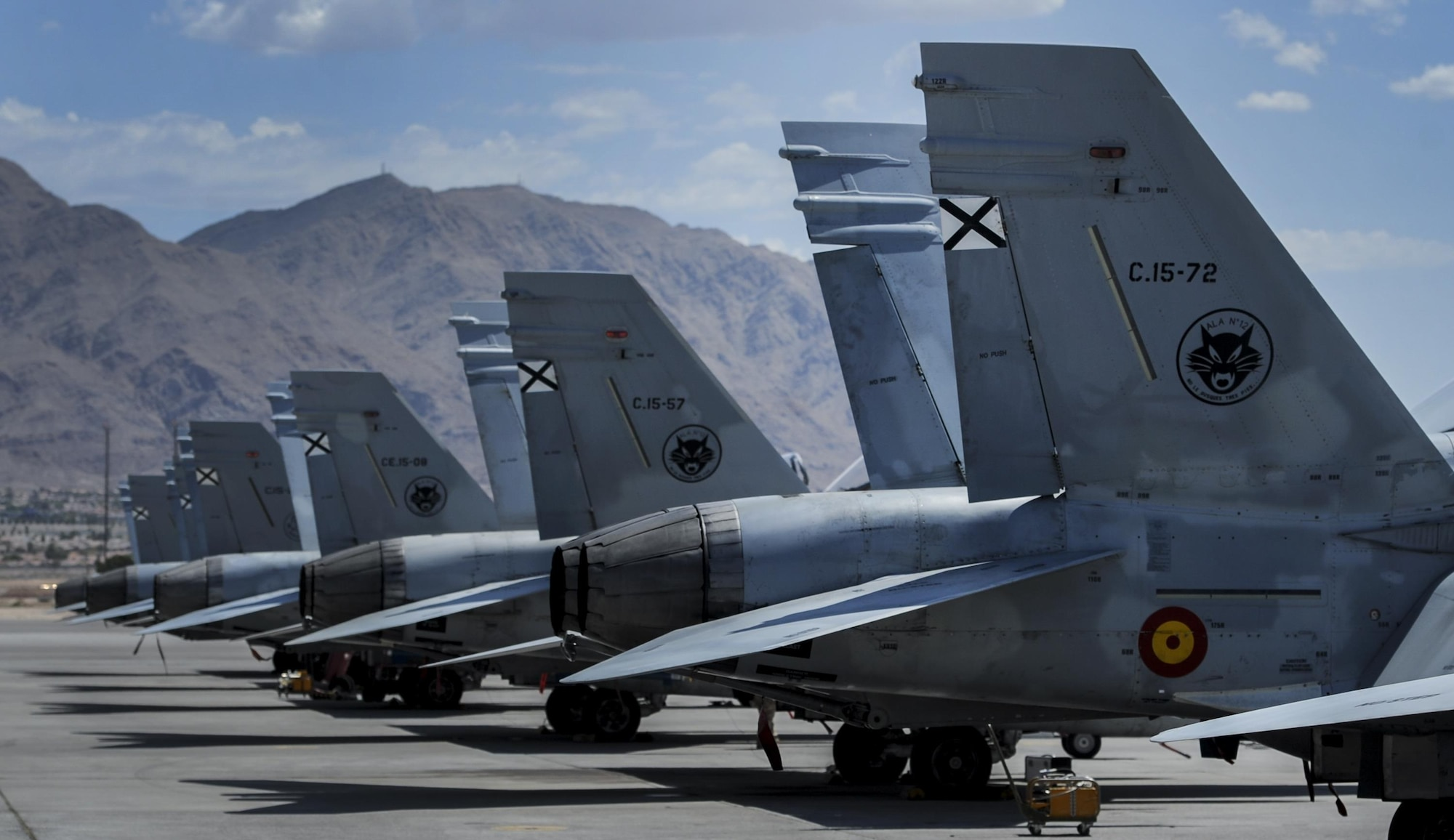 Spanish air force EF-18Ms sit on the runway at Nellis Air Force Base, Nev. during Red Flag 16-4, Aug. 17, 2016. Red Flag was established in 1975 as one of the initiatives directed by General Robert J. Dixon, then commander of Tactical Air Command, to better prepare our forces for combat. (U.S. Air Force photo by Airman 1st Class Kevin Tanenbaum/Released)