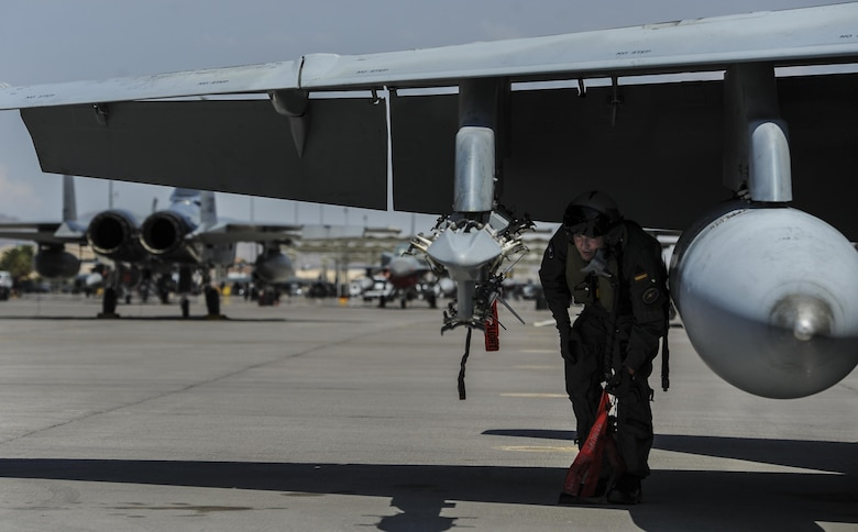 A Spanish air force pilot performs preflight checks on the runway at Nellis Air Force Base, Nev., before flying in Red Flag 16-4, Aug. 17, 2016. The integration of coalition partners from around the world is an important factor in a Red Flag exercise, as it offers a realistic battlespace in which U.S. and allied warfighters work together towards a set of common objectives. (U.S. Air Force photo by Airman 1st Class Kevin Tanenbaum/Released)