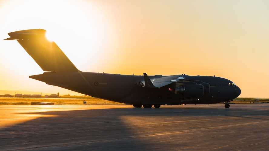 A  Royal Australian Air Force C-17 Globemaster III taxis to its destination at Mountain Home Air Force Base, Idaho, July 28, 2016. The RAAF came to the base to pick up several 266th Range Squadron personnel and threat emitters for it's annual Pitch Black exercise.(U.S. Air Force photo by Senior Airman Connor J. Marth)