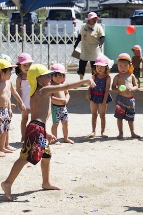 A Japanese local preschooler throws a water balloon during a water fight at Midoro Hoikuen in Iwakuni, Japan, Aug. 23, 2016. The Marine Memorial Chapel had been hosting community relations preschool visits for 12 years, and gives Marine Corps Air Station Iwakuni residents an opportunity to volunteer their time with local Japanese children. (U.S. Marine Corps photo by Lance Cpl. Joseph Abrego)