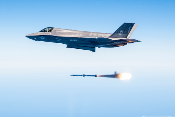 Maj. Douglas Rosenstock fires an AIM-120 AMRAAM from an F-35 Lightning II during a recent weapons test surge at Edwards Air Force Base, Calif. By the end of the surge the F-35 Integrated Test Team released 30 weapons in 31 days, a first in flight testing. (Lockheed Martin photo/Darrin Russel)