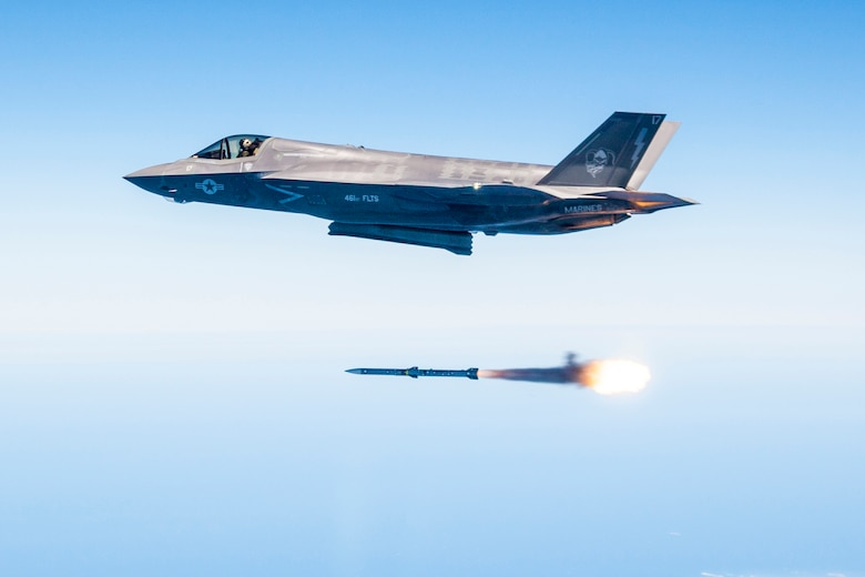 Maj. Douglas Rosenstock fires an AIM-120 missile from an F-35 during a recent weapons test surge here. By the end of the surge the F-35 Integrated Test Team released 30 weapons in 31 days, a first in flight test. (Photo by Darrin Russel/Lockheed Martin)