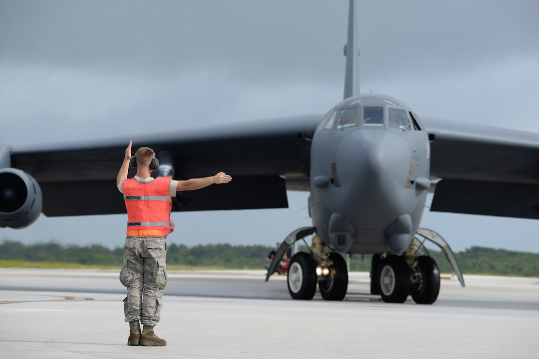 Senior Airman Logan Chufar, a 36th Expeditionary Aircraft Maintenance Squadron crew chief deployed from Minot Air Force Base, N.D., marshals a B-52 Stratofortress at Andersen Air Force Base, Guam, Aug. 24, 2016. The B-52s have served non-stop rotations since 2006, which have been shared between the bomber squadrons from Minot AFB, N.D., and Barksdale AFB, La. (U.S. Air Force photo by Airman 1st Class Jacob Skovo)