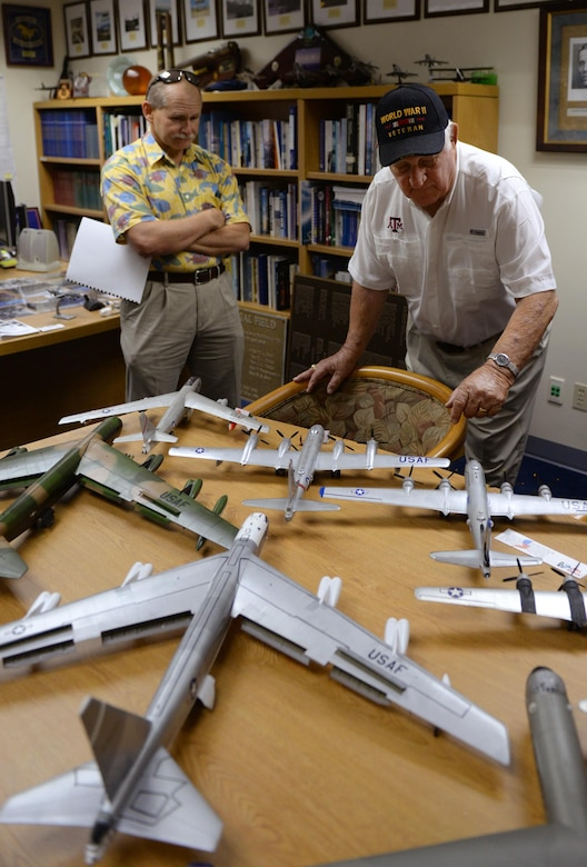 Rowland Ball, a World War II veteran, looks at an assortment of model aircraft during a visit to Andersen Air Force Base, Guam, Aug. 16, 2016. Ball served in the United States Army Air Corps as a B-29 Superfortress navigator during the tail end of World War II, where he flew 27 missions out of Guam. (U.S. Air Force photo by Staff Sgt. Benjamin Gonsier)
