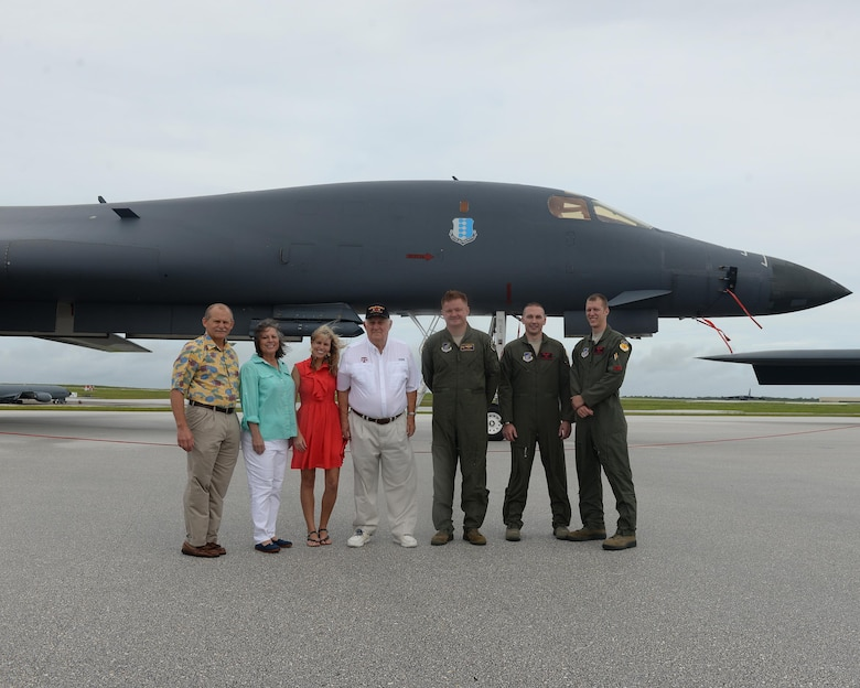 Rowland Ball, a World War II veteran, family members and Team Andersen Airmen pose for a photo in front of a B-1B Lancer during a visit to Andersen Air Force Base, Guam, Aug. 16, 2016. Ball served in the United States Army Air Corps as a B-29 Superfortress navigator during the tail end of World War II, where he flew 27 missions out of Guam. (U.S. Air Force photo by Staff Sgt. Benjamin Gonsier)