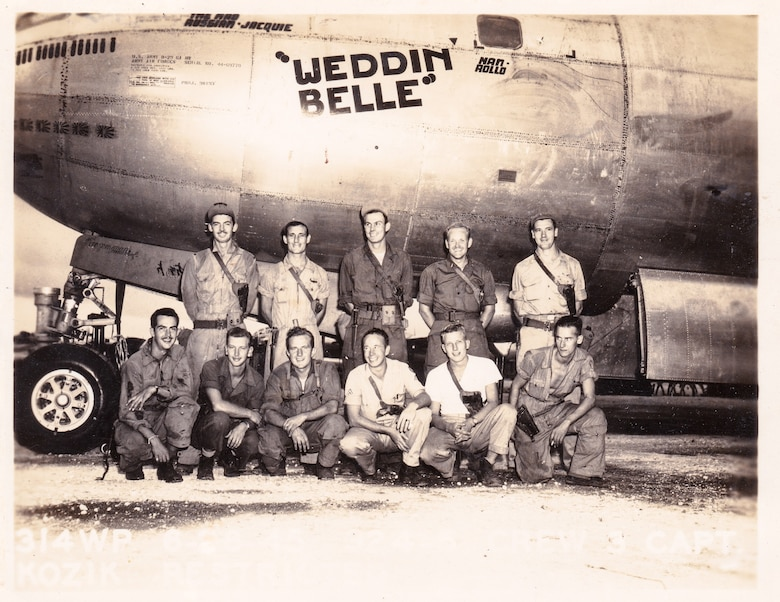 Rowland Ball, top row, second from the left, with his crew members