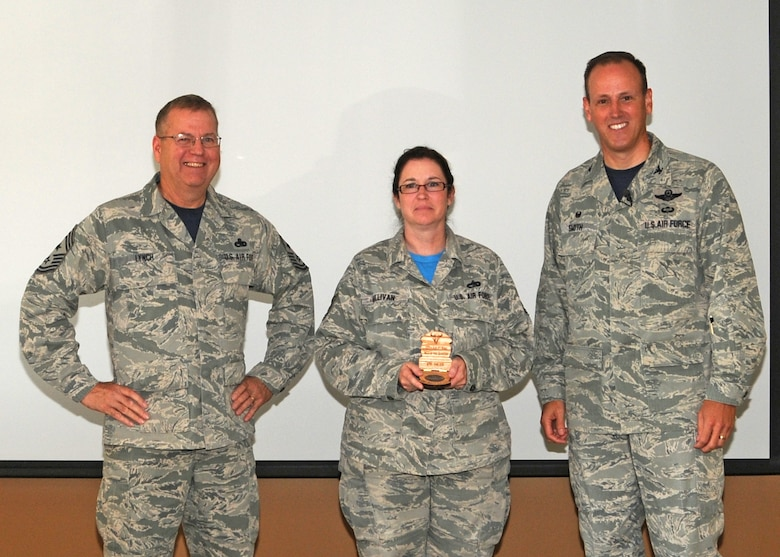 120th Airlift Wing Commander Col. Lee Smith and 120th AW Command Chief, Chief Master Sgt. Steven Lynch, present the Noncommissioned Officer of the Quarter Award to Tech. Sgt. Deana Sullivan during a commander's call held in the Larsen Room of the Wing Headquarters Building during the regularly scheduled drill August 13, 2016. (U.S. Air National Guard photo by Staff Sgt. Lindsey Soulsby)