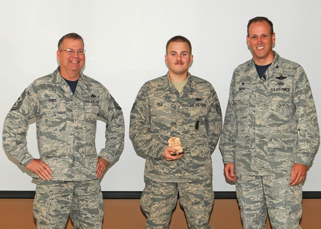 120th Airlift Wing Commander Col. Lee Smith and 120th AW Command Chief, Chief Master Sgt. Steven Lynch, present the Airman of the Quarter Award to Staff Sgt. Jedidiah Polk during a commander's call held in the Larsen Room of the Wing Headquarters Building during the regularly scheduled drill August 13, 2016. (U.S. Air National Guard photo by Staff Sgt. Lindsey Soulsby)