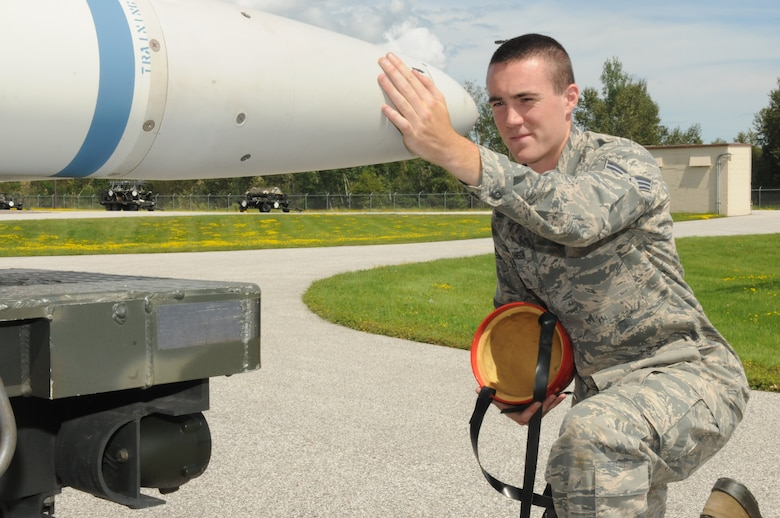 Senior Airman Bryan Johnson, 148th Fighter Wing, Duluth, Minn. inspects the guidance section of a missile, Aug. 8, 2016.  Johnson is a Munitions Specialist with the Wing and is taking classes with a goal of becoming a physical therapist.  (U.S. Air National Guard photo by Master Sgt. Ralph Kapustka)