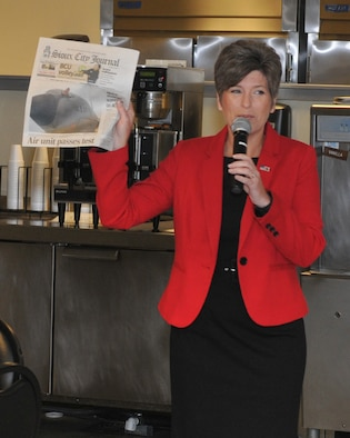 U.S. Senator Joni Ernst (R-Iowa) holds up a copy of today's Sioux City Journal featuring the 185th Air Refueling Wing on the front page during a visit to the 185th ARW, in Sioux City, Iowa on August 25th, 2016.  Ernst held a town hall meeting with unit members where she congratulated them for successfully completing a unit readiness inspection earlier this week.  (U.S. Air National Guard photo by Tech Sgt. Bill Wiseman/Released)