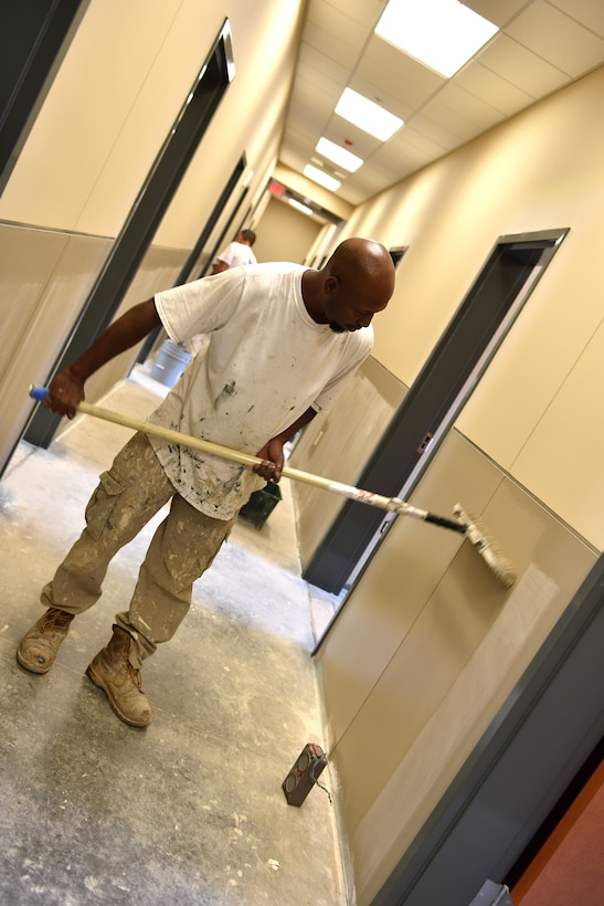 A paint crew makes progress here August 25, 2016, in a hallway on the first floor of the dormitory building under construction at the I.G. Brown Training and Education Center on McGhee Tyson Air National Guard Base in Louisville, Tenn. The painters were busy throughout the summer. The lower wall color is named Sycamore Tan and the upper color is Bittersweet Stem. (U.S. Air National Guard photo by Master Sgt. Mike R. Smith)