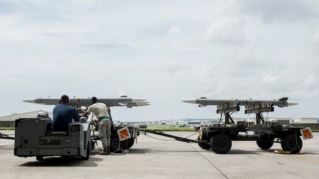 Maintainers from the 18th Aircraft Maintenance Squadron and pilots assigned to the 44th and 67th Fighter Squadrons conduct a mass aircraft generation exercise Aug. 22 and 23, at Kadena Air Base, Japan. Maintainers loaded AIM-9 sidewinder missiles, AIM-120 advanced medium-range air-to-air missiles, flares, and M-61A1 cannon rounds onto F-15 Eagles, before the aircraft taxied and were dispersed around the flight line. Kadena participates in a variety of routine training exercises throughout the year to maintain a consistent high standard of readiness and expertise. F-15s assigned to Kadena Air Base taxied on the flight line during a training exercise Aug. 23 while loaded with live ammunition. This training was not in response to or in anticipation of any regional concerns. While no planes took off from the flightline, this routine exercise helped ensure Kadena's ability to provide air superiority in the defense of Japan and promoting peace and stability throughout the Indo-Asia-Pacific region. (U.S. Air Force photo by Senior Airman Peter Reft/Released)