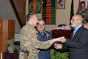 Brig. Gen. David Hicks, Train, Advise, Assist Command-Air (TAAC-Air) and 438th Air Expeditionary Wing commander, accepts certificates of appreciation for TAAC-Air advisors during a ceremony celebrating the Afghan air force's 95th birthday at Kabul Air Wing, Afghanistan, Aug. 24, 2016. Other members of TAAC-Air also attended the ceremony marking the historic occasion. TAAC-Air advisors work shoulder to shoulder with AAF members to strengthen the AAF's war fighting capabilities. (U.S. Air Force photo by Tech. Sgt. Christopher Holmes)