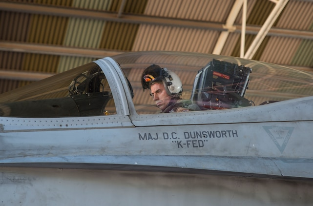 U.S. Marine Corps Maj. David Dunsworth, an F/A-18C Hornet pilot with Marine Fighter Attack Squadron (VMFA) 122, prepares to taxi out of a hangar during Southern Frontier at Royal Australian Air Force Base Tindal, Australia, Aug. 24, 2016. VMFA-122 executed close air support missions for ground combat units conducting exercises at Bradshaw Range Complex. Southern Frontier is a three week unit level training evolution helping the flying squadron gain qualifications and experience in low, air ground, high explosive ordnance delivery. (U.S. Marine Corps photo by Cpl. Nicole Zurbrugg)