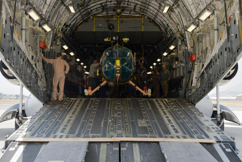 Four new MD-530 Cayuse Warrior helicopters arrived at Hamid Karzai International Airport, Afghanistan, Aug. 25, 2016, via a C-17 Globemaster III. The four helicopters, scheduled to be the final four delivered to the Afghan air force, brings the AAF total number of MD-530s to 27. (U.S. Air Force photo by Tech. Sgt. Christopher Holmes)
