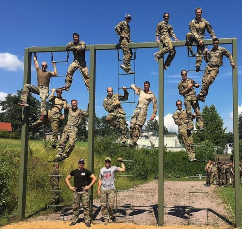 From left to right from the top: First ladder: Maj. Mike Masuda (top), Col. Scott Banning, Capt. Chuck Francis, Lt Col. Bob Houghteling and Staff Sgt. Matt Gaddy (black shirt). Second ladder: Lt. Col. Elizabeth Blanchford, Staff Sgt. Reuben Sublett (left, Army Reserve), Maj. Pete Grossenbach (right) and Capt. Beau Suder (bottom). Third ladder: Maj. Caitlin Harris (top), 2nd Lt. Nate Davis, Mississippi Army National Guard (top right), 1st Lt. Sterling Broadhead, Maj. Jamie Turner and Capt. Amy Moore.