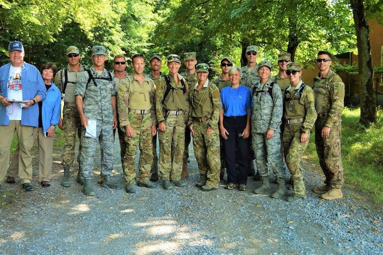 From left to right: Retired Col. Chuck Ferguson (USAFR), orienteering coach; Linda Ferguson, orienteering coach; Competitors: Maj. Pete Grossenbach, Lt. Col. Bob Houghteling, Capt. Ryan Ruddy, Capt. Chuck Francis, Maj. Mike Masuda, Maj. Jamie Turner, Staff Sgt. Reuben Sublett (Army Reserve), Maj. Caitlin Harris, Staff Sgt. Matt Gaddy; Andi Berger, orienteering coach; Col. Scott Banning, U.S. chief of delegation; Competitors: Lt. Col. Elizabeth Blanchford, 2nd Lt. Nate Davis (Mississippi Army National Guard), Capt. Amy Moore and 1st Lt. Sterling Broadhead.