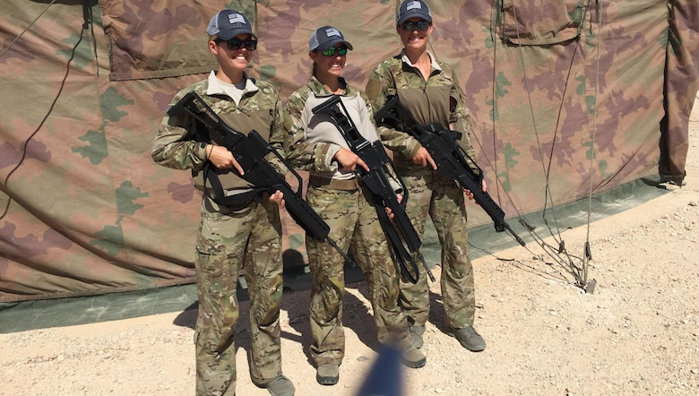 USA Team 2, Capt. Amy Moore, Maj. Caitlin Harris and Maj. Jamie Turner, proudly display their G-36 Assault Rifles prior to entering the scoring tent to sign their targets.  Jamie finished 40th of 78 competitors.
