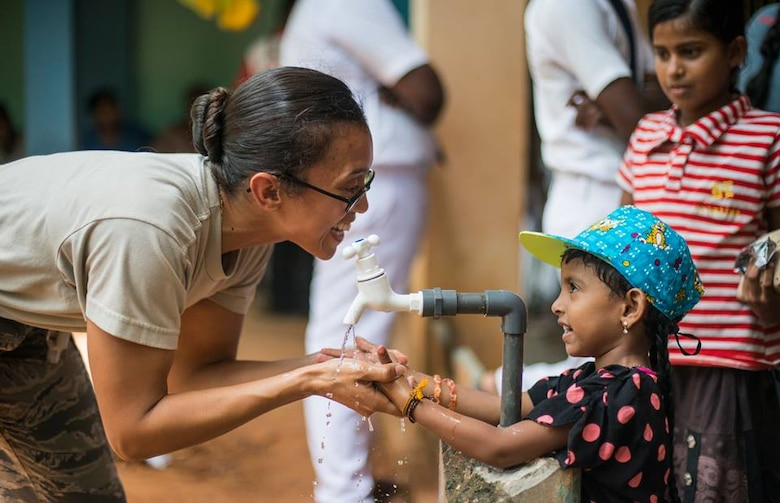 Staff Sgt. Yesenia Benjamin, an 18th Medical Group public health technician, teaches a Sri Lankan child how to properly wash her hands during Pacific Angel 16-3 in Jaffna, Sri Lanka, Aug. 16, 2016. Now entering its ninth year, Operation Pacific Angel ensures that the region's militaries are prepared to work together to address humanitarian crises. Since 2007, Pacific Angel operations have improved the lives of tens of thousands of people. (U.S. Air Force photo/Senior Airman Brittany A. Chase)