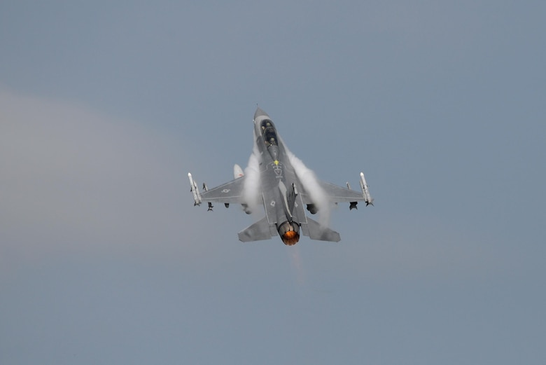 """An F-16D Fighting Falcon, piloted by Col. John R. DiDonna, the commander of the New Jersey Air National Guard's 177th Fighter Wing, takes off in afterburner with Brig. Gen. Robert C. Bolton in the back seat for his """"fini flight"""" at the Atlantic City Air National Guard Base in Egg Harbor Township, N.J., Aug. 16, 2016. (U.S. Air Force photo/Master Sgt. Andrew J. Moseley)"""