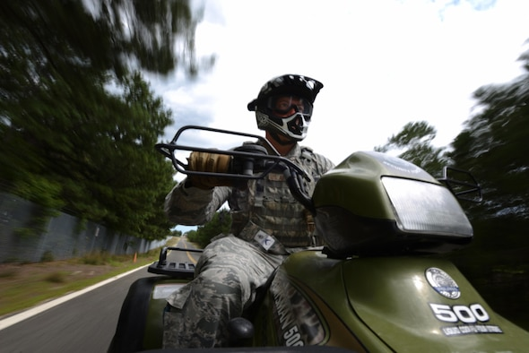 Master Sgt. Paul W. Clementi, a member of the 106th Security Forces Squadron, trains on an all-terrain vehicle at Francis S. Gabreski Air National Guard Base, N.Y., Aug. 18, 2016. ATVs are used by security forces to maintain the integrity of the base perimeter. Members must regularly train in order to retain their proficiency. (U.S. Air National Guard photo/Staff Sgt. Christopher S. Muncy)